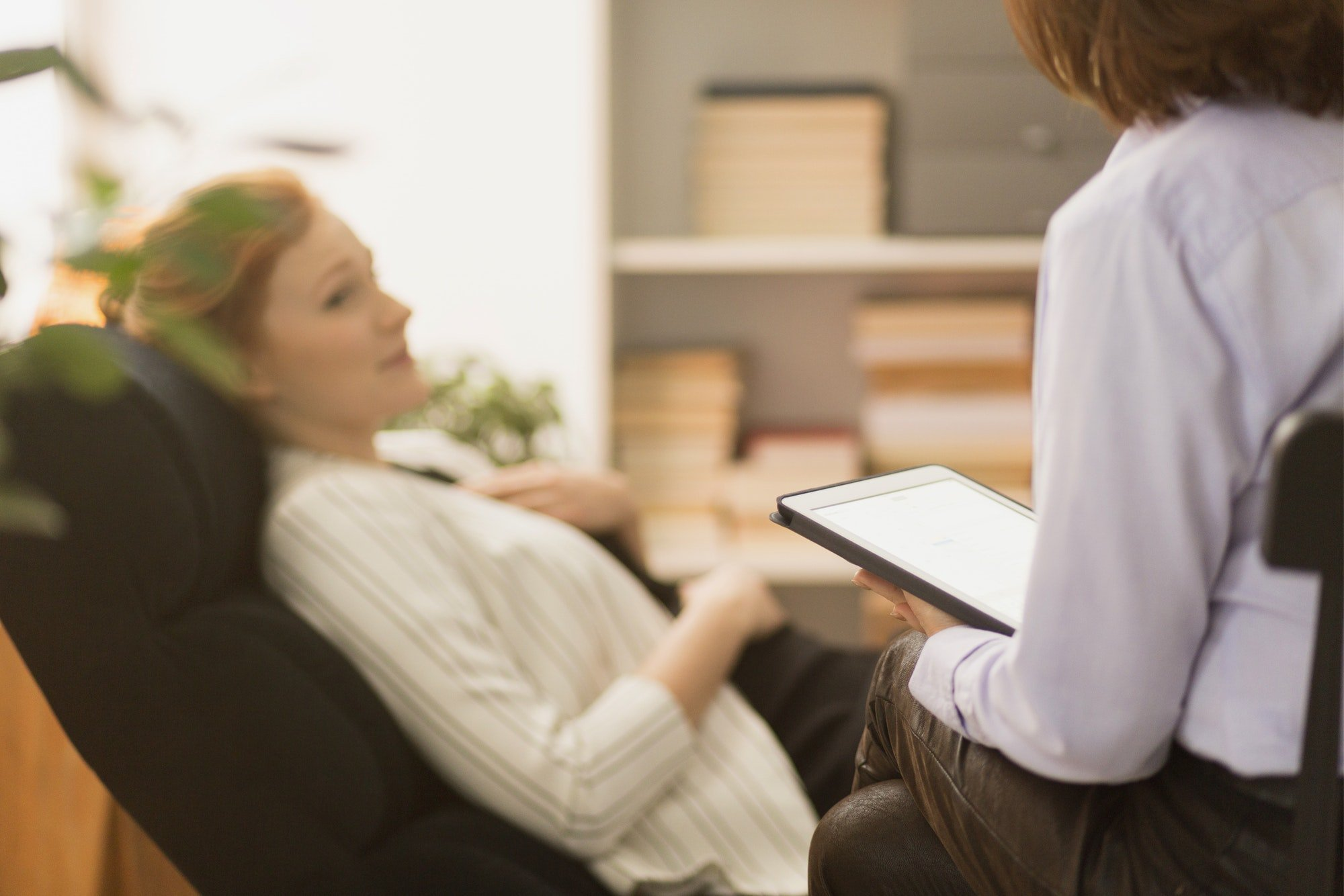 Psychiatrist interviewing patient